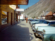 Parked Cars, Cadillac, Chevy, buildings, wooden boardwalk, Teton Village, 1950's