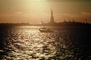Statue Of Liberty, boat, sun sheen, water
