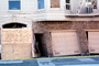 Bent Garage Doors, Marina district, Loma Prieta Earthquake, (1989), 1980's