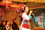 Woman Singing, Singer, paper lamps, sword, Naxi Musicians, Lijiang, China, EMAV02P01_11