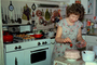 Woman Baking a Cake, Birthday, Stove, Utensils, Kitchen, Cupcakes, June 1973, 1970's, FDNV02P06_15