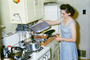 Woman Cooking in the Kitchen, Meat, Gas Stove, frying pan, egg beater, May 1960, 1960's, FDNV02P07_02