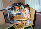 Baby Drinking in Kitchen, Highchair, toddler, barefeet, barefoot, 1960's, FDNV02P13_01