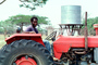 Man with Tractor, Water Tank, Madzongwe, Zimbabwe