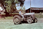 Man and Boy on Tractor, 1950's