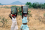 Girls Carrying water back to the village, Child-Labor