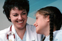Doctor and girl patient, smiles, Female, Woman