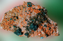 Calcite with included Chalcotrichite , Malachite