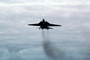 Grumman F-14 Tomcat with tailhook, landing, exhaust smoke, pollution
