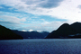 Kingcome Inlet, fjord, Mountains, water, coast, coastline, clouds, April 1996, NCBV01P09_18