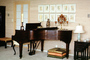 grand piano, musical Instrument, lamp, pillows, artwork, candle, pillows