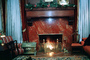 Fire in the Fireplace, mantle, chair