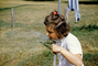 girl drinking water from a hose, 1950's, PDGV01P08_13