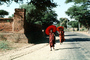 Monks Walking down the street, Bagan, Myanmar