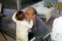 dad and child, kiss, love, glass door, May 1966, 1960's, PHBV03P05_16