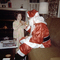 Girl talking with Santa Claus, pajama, suit, 1950's