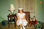 Smiling Girl, Hat, Smiles, Lamp, curtains, formal dress, lampshade, April 1958, 1950's, PHEV01P01_09