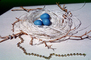 Blue eggs, paper nest, jewelry, twigs, PHEV01P03_06