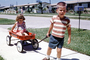 boy, girl, brother, sister, wagon, mailbox, sidewalk, 1960's, PLGV03P04_17