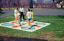 Parcheesi board game, towel, cloth, girls, boys, frontyard, May 1968, 1960's