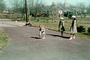 Hopscotch, driveway, girls, hats, coats, Backyard, May 1965, 1960's