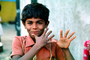 Smiling Boy, face, hands, Mumbai, India, PLPV03P13_09