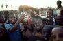 Children holding up an Ostrich Egg, smiles, funny, fun, Exuberance, PLPV04P11_10