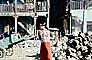 Woman Stands waiting for a bus, Slum, Mumbai, (Bombay), India, POVV01P08_19