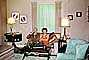 Couple Drinking, Lamps, Sofa, Curtains, Chairs, lampshade, drapes, 1950's, PSAV01P01_13