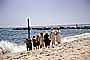 Women and Men on the beach, sand, water, jetty, Long Island, 1950's, RVLV06P14_06