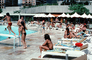 Swimming Pool, Poolside, lounge chairs, umbrellas, parasol, 1977, 1970's, RVLV07P12_03