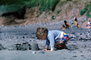 Boy making a sand castle, beach, toddler, RVLV10P03_05