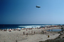 Volleyball, beach, sun worshipers, crowds, people, shoreline, Goodyear Blimp, Pacific Ocean