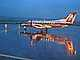 N569SW, Reflection on a Rainy evening in Portland, Embraer EMB-120ER, TAFD01_165B