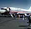 N9069U, Boeing 737-222, disembarking passengers, named City of Toledo JT8D-7B ,April 1974, 1970's, TAFV36P14_01