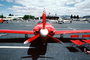 LANCAIR, red plane head-on, propeller, spinner