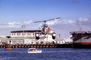 Santa Claus Delivering Presents, N9763Z, Bell 47G-2, pontoons, floats, San Pedro Harbor, docks, 1978, 1970's, TAHV04P06_11