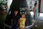 Boy and Girl stand in front of the Mercury Space Capsule, 1960's, USEV01P05_18