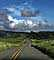 Curve coming in the road, hills, mountains, clouds, VCRD03_045