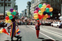 Rainbow Balloons, crowds, unicycle, downtown-SF, clowns, Powell Street at Union Square, CC celebration June 21 1984, 1980's, VRCV01P03_17