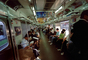 Crowded Train, interior, inside, railcar, commuters, people